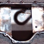 Oil pan with baffles, reinforments, and a bung